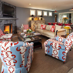 This is an example of a traditional living room in Minneapolis with a corner fireplace, grey walls and a stone fireplace surround.
