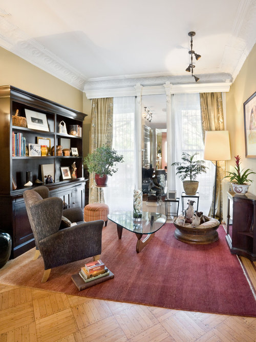 Small elegant enclosed living room photo in New York with beige walls
