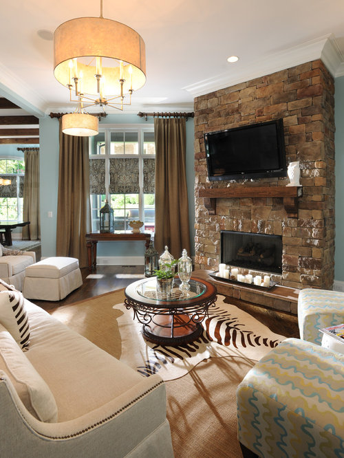 Traditional Living Room Idea In Nashville With Blue Walls A Stone Fireplace Surround And