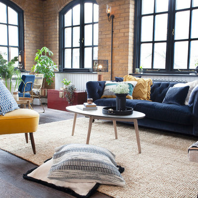 Inspiration for a small industrial open concept dark wood floor and brown floor living room remodel in London