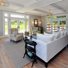 Farmhouse Living Room by JPS Construction and Design, LLC