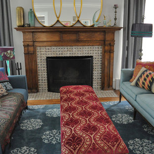 Example of an eclectic living room design in Chicago with a tile fireplace