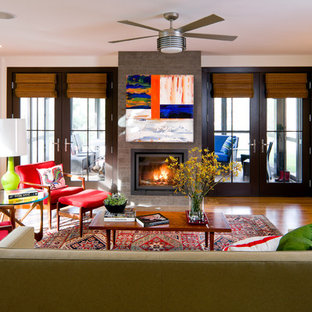 Inspiration for a contemporary living room remodel in Boston with a standard fireplace
