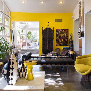 Living room - eclectic concrete floor living room idea in Portland with yellow walls