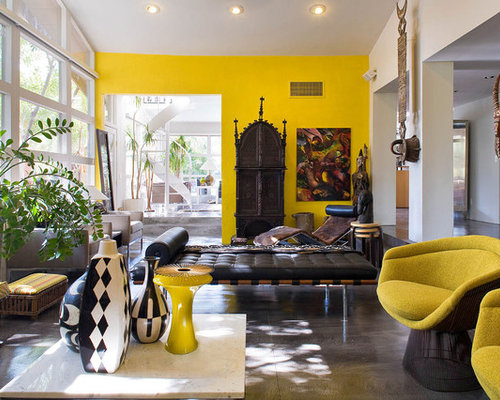 Eclectic Living Room Idea In Portland With Yellow Walls And Concrete Floors