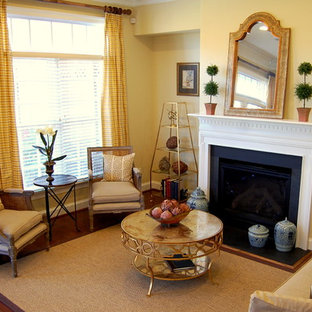 Inspiration for an eclectic living room remodel in Richmond with yellow walls