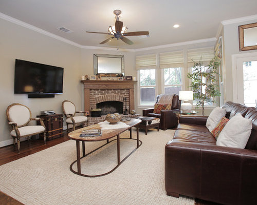 Mountain Style Living Room Photo In Dallas With A Brick Fireplace Surround And Corner
