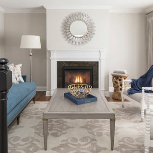 Living room - mid-sized contemporary formal and open concept medium tone wood floor and brown floor living room idea in Minneapolis with beige walls, a standard fireplace, a wood fireplace surround and no tv