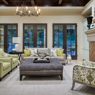 Example of a classic formal living room design in Austin with beige walls and a standard fireplace