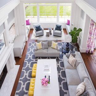 Idee per un ampio soggiorno classico aperto con camino classico, cornice del camino in pietra, sala formale, nessuna TV, pareti grigie, pavimento in legno massello medio e pavimento marrone