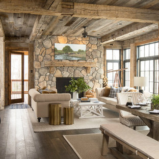 Large rustic formal open plan living room in Minneapolis with brown walls, carpet, no fireplace, no tv and beige floors.
