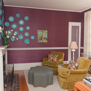 Photo of a large traditional formal enclosed living room in Boston with purple walls, medium hardwood floors, a standard fireplace and a brick fireplace surround.