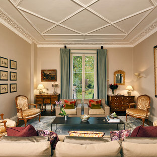This is an example of a victorian formal living room in London with beige walls, dark hardwood flooring and brown floors.