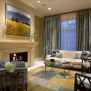 Example of a classic living room design in Chicago with beige walls and a standard fireplace