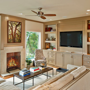 Example of a transitional living room design in Dallas with a standard fireplace and a media wall