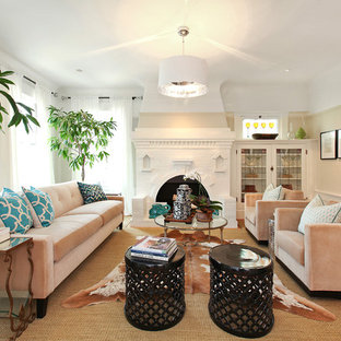 Example of a trendy living room design in San Francisco with beige walls, a standard fireplace and a brick fireplace