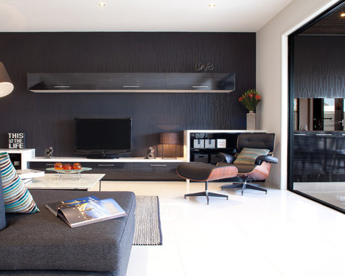 Example Of A Trendy Living Room Design In Melbourne With Black Walls And A  Tv Stand