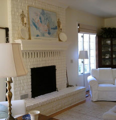 eclectic living room living room  painted brick fireplace