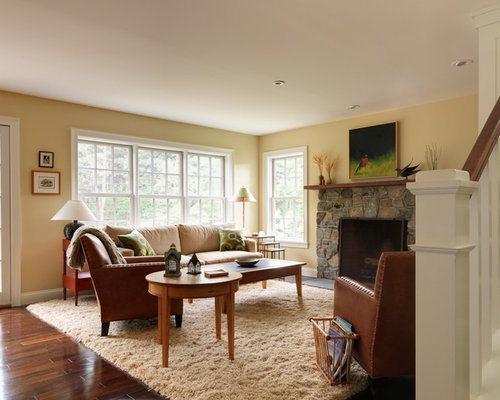 Example Of A Classic Living Room Design In Burlington With Yellow Walls