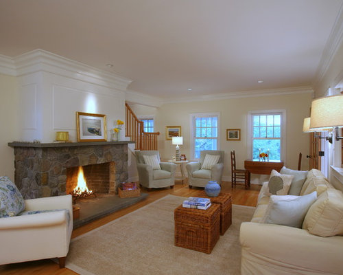 example of a large classic open concept medium tone wood floor living room design in boston