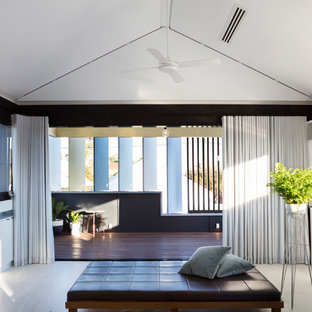 Example of a mid-sized coastal enclosed plywood floor and white floor living room design in Perth with white walls