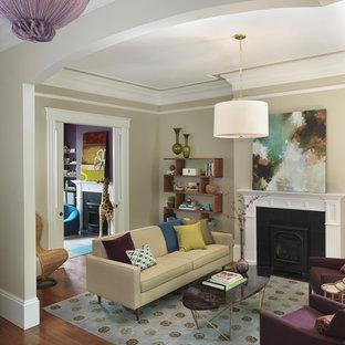 Foto de salón clásico renovado, sin televisor, con paredes beige, chimenea tradicional y suelo de madera en tonos medios
