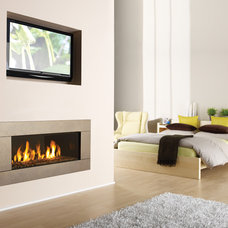 living room by Regency Fireplace Products