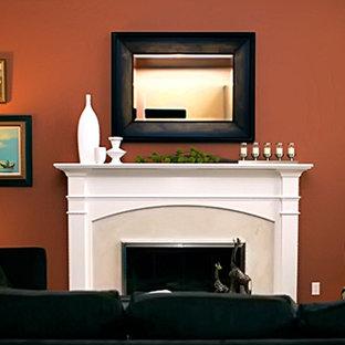 サンフランシスコの大きいトランジショナルスタイルのおしゃれな独立型リビング (オレンジの壁、標準型暖炉、テレビなし、フォーマル、カーペット敷き、石材の暖炉まわり) の写真
