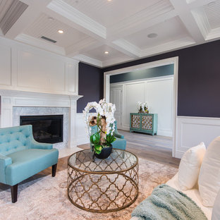 Photo of a mid-sized contemporary formal open concept living room in Los Angeles with purple walls, dark hardwood floors, a standard fireplace, a stone fireplace surround and no tv.