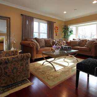 Inspiration for a small timeless open concept medium tone wood floor living room remodel in New York with brown walls