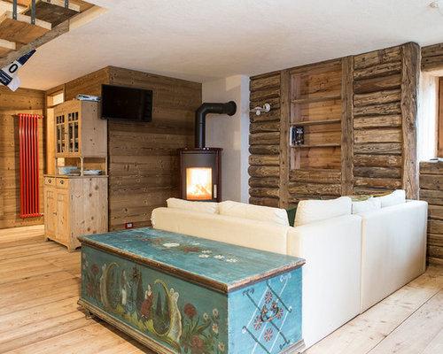Soggiorno in montagna con stufa a legna foto e idee per for Soggiorno montagna