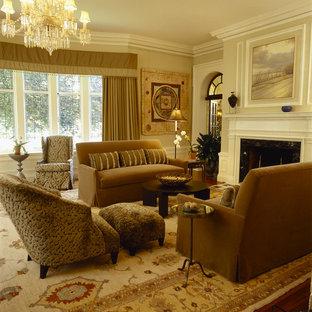 ニューヨークの広いエクレクティックスタイルのおしゃれな独立型リビング (フォーマル、ベージュの壁、標準型暖炉、木材の暖炉まわり、無垢フローリング、テレビなし、茶色い床) の写真