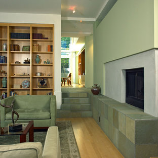 Photo of a modern living room in Los Angeles with a concrete fireplace surround.