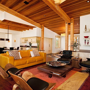 Design ideas for a mid-sized country formal open concept living room in Sacramento with white walls, bamboo floors and no tv.