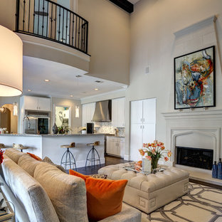 Mediterranean open concept living room in Dallas with beige walls, a standard fireplace and no tv.