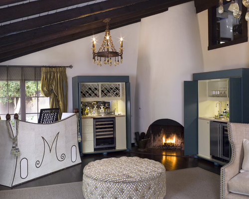 Mediterranean Living Room Idea In Los Angeles With A Corner Fireplace And  White Walls