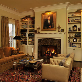 This is an example of a medium sized classic formal enclosed living room in Atlanta with beige walls, dark hardwood flooring, a standard fireplace, a stone fireplace surround and no tv.