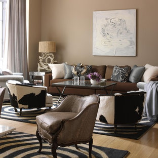 This is an example of a large traditional formal open plan living room in New York with beige walls, light hardwood flooring, no fireplace, no tv, beige floors and feature lighting.