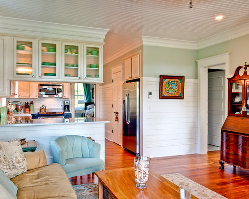Example Of An Ornate Living Room Design In Charleston With Green Walls