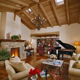 Living room - traditional brown floor living room idea in Santa Barbara with a music area and a stone fireplace