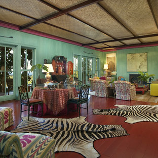 Inspiration for an eclectic red floor living room remodel in Santa Barbara with green walls