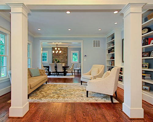 Example Of A Classic Living Room Design In DC Metro With Library And Blue Walls