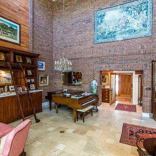 Diseño de salón con rincón musical cerrado, clásico, extra grande, sin televisor, con paredes marrones, suelo de piedra caliza, chimenea de doble cara, marco de chimenea de ladrillo y suelo beige