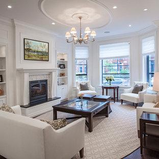 Foto di un grande soggiorno classico chiuso con sala formale, pareti bianche, parquet scuro, camino classico, cornice del camino in legno e nessuna TV
