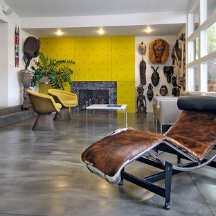 Living room with bright yellow fireplace