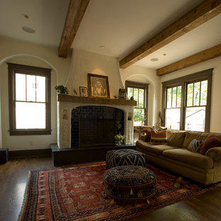 Example of a tuscan dark wood floor living room design in Nashville with a standard fireplace