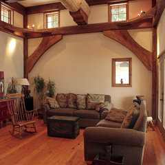 traditional living room by Traditional Log Homes Ltd