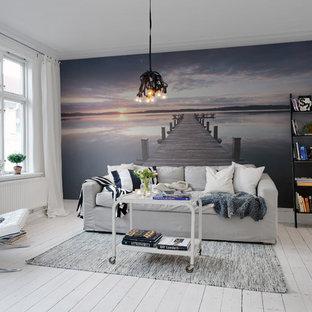 ニューカッスルのビーチスタイルのおしゃれなリビング (フォーマル、グレーの壁、塗装フローリング) の写真