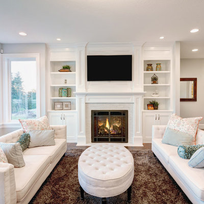 Living room - traditional formal dark wood floor living room idea in Denver with white walls, a standard fireplace and a wall-mounted tv