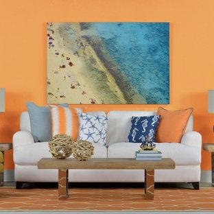 ロサンゼルスのビーチスタイルのおしゃれなリビング (オレンジの壁) の写真